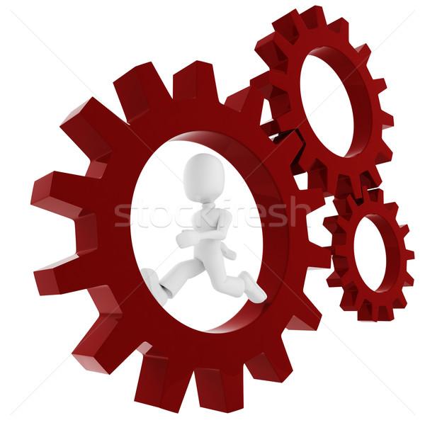 Stock photo: 3d man inside a gear wheel