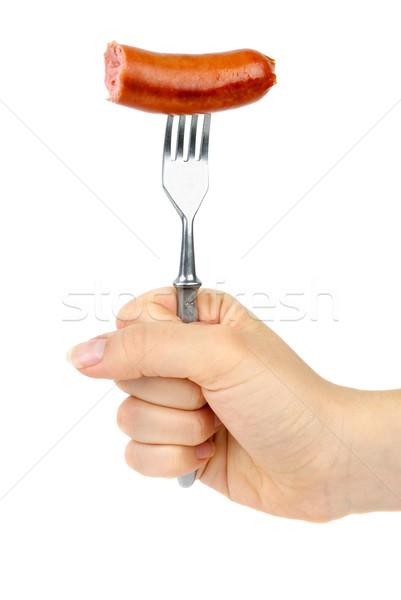Hand holding half eaten sausage on fork. Stock photo © digitalr