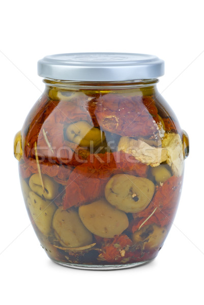 Green greek olives conserved with dried tomato and cheese in the glass jar Stock photo © digitalr