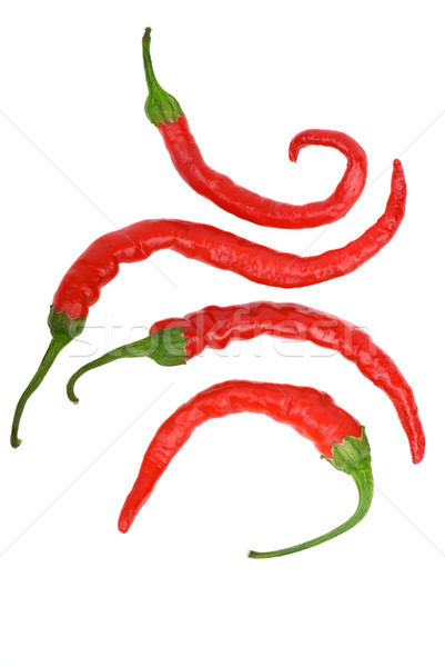 Four crooked red hot chili peppers Stock photo © digitalr