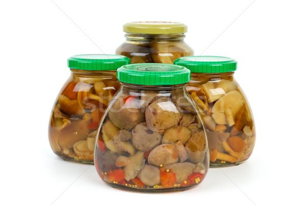 Four glass jars with marinated mushrooms Stock photo © digitalr
