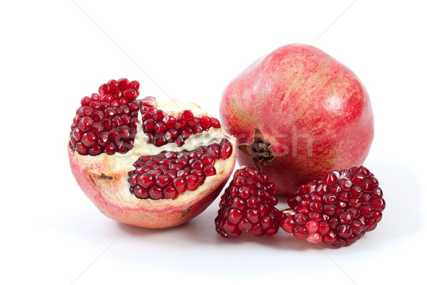 Whole pomegranate, half and pieces Stock photo © digitalr