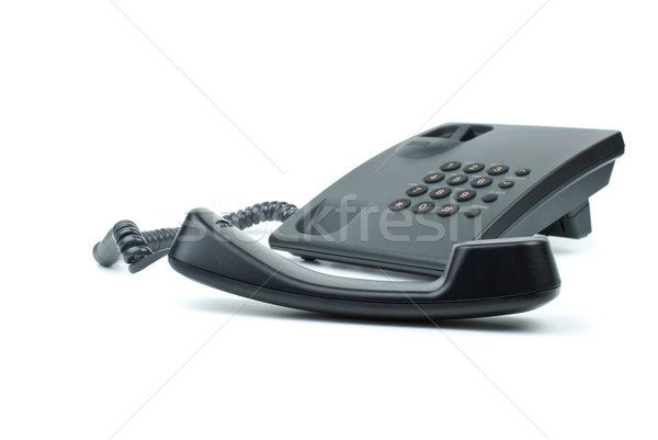 Black office phone with handset in foreground Stock photo © digitalr