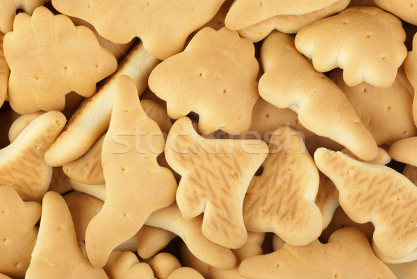 Abstract background:  dinosaur-shaped cookies Stock photo © digitalr