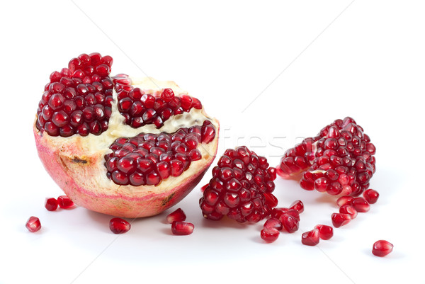 Half of pomegranate, piece and some berries Stock photo © digitalr