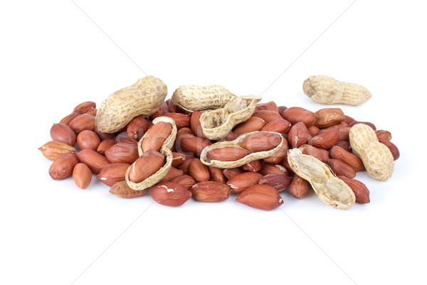 Some whole, shelled roasted peanuts and husk Stock photo © digitalr