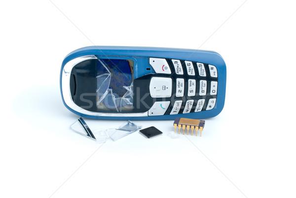 Podziale telefon komórkowy dwa odizolowany biały komórkowych Zdjęcia stock © digitalr