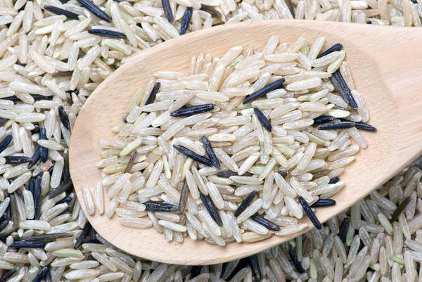 Raw white and black uncultivated rice and wooden spoon Stock photo © digitalr