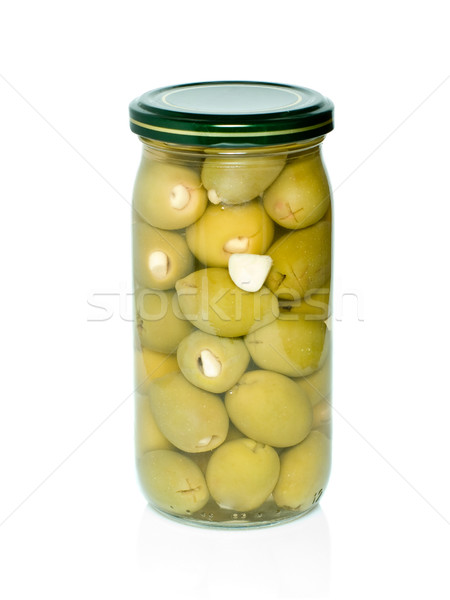 Olives with garlic conserved in glass jar Stock photo © digitalr