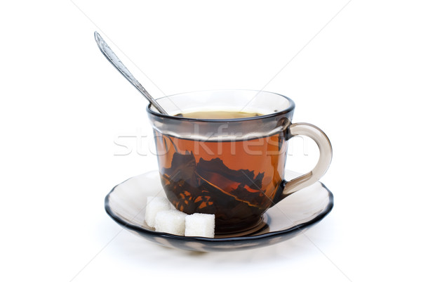 Teacup with black tea, teaspoon, dish and some sugar pieces Stock photo © digitalr