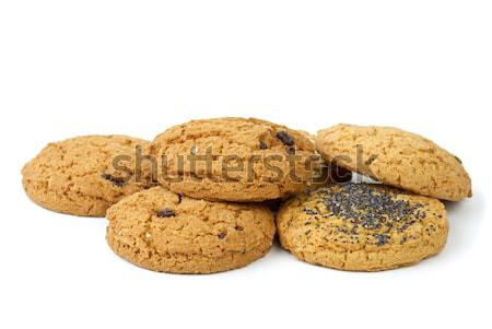 Few oatmeal cookies (with raisins, sesame and poppy seeds) isolated on the white background Stock photo © digitalr
