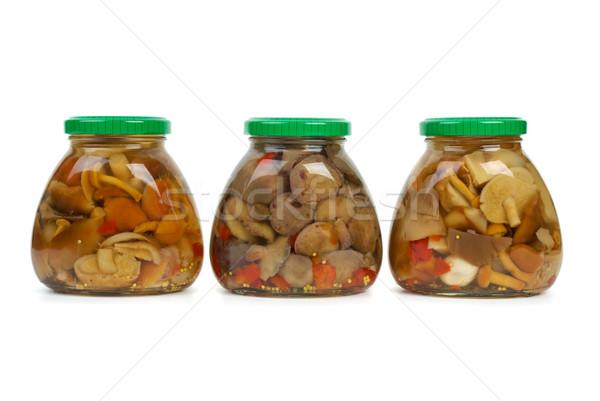 Tre vetro marinato funghi isolato bianco Foto d'archivio © digitalr