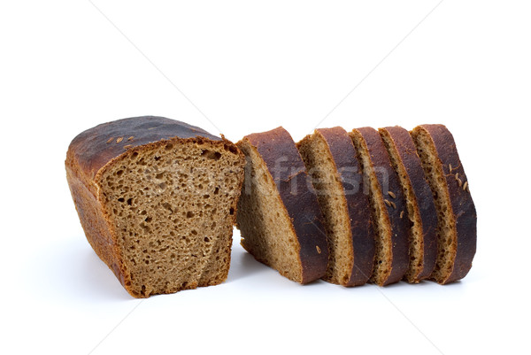 Chunk of rye bread with anise and some slices Stock photo © digitalr
