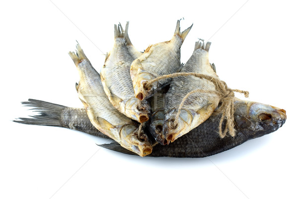 Five dried sea roach fishes on the rope and bream fish Stock photo © digitalr