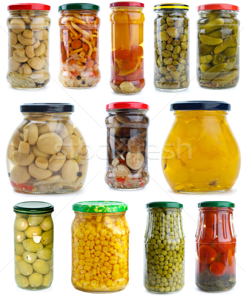 Set of different berries, mushrooms and vegetables conserved in glass jars Stock photo © digitalr