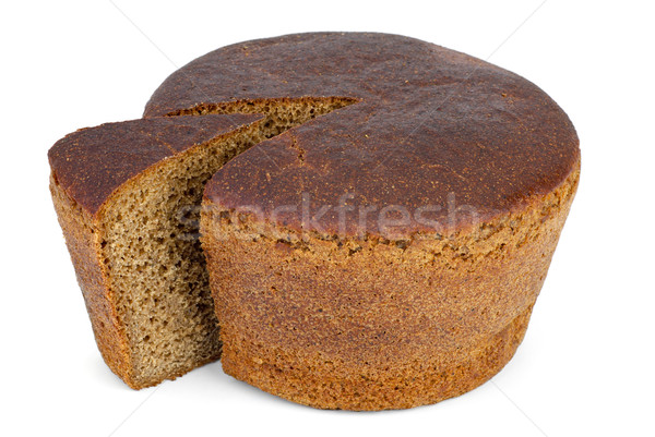 Round loaf of rye bread with piece cut Stock photo © digitalr