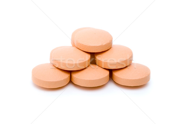 Few orange tablets lie in form of pyramid Stock photo © digitalr