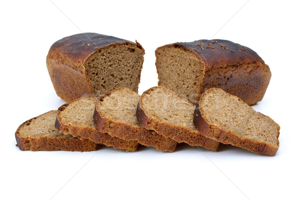 Two chunks of rye bread with anise and some slices Stock photo © digitalr