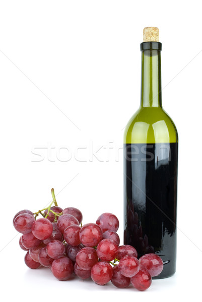 Stock photo: Wine bottle and grapes isolated on the white background