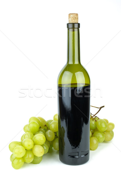 Bottle with red wine and green grapes near Stock photo © digitalr