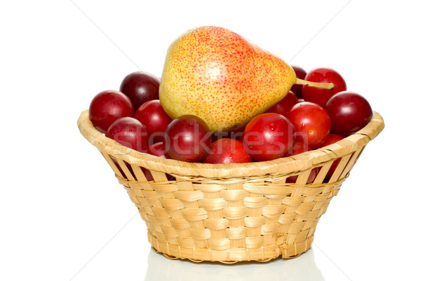 Wicker basket with cherry plums and yellow-red pear Stock photo © digitalr