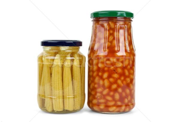 Glass jars with marinated corn ears and harricot beans Stock photo © digitalr