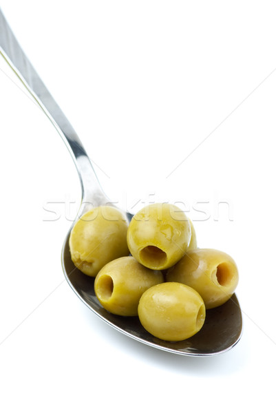 Five marinated pitted green olives in the metal spoon Stock photo © digitalr