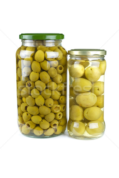 Glass jars with pitted and giant green olives Stock photo © digitalr