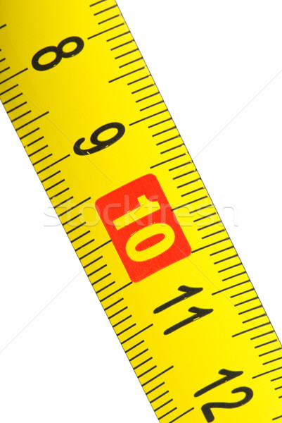 Close-up shot of yellow metal measurement tape Stock photo © digitalr