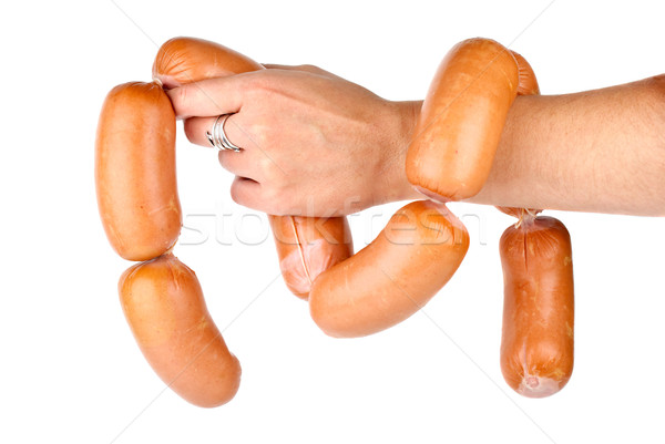 Hand holding sausages chain isolated on the white background Stock photo © digitalr