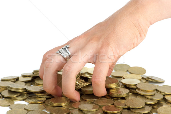 Hand grabbing coins from the pile Stock photo © digitalr