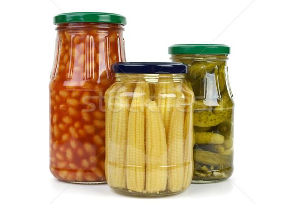Glas jars with cornichons, haricot beans and corn ears Stock photo © digitalr