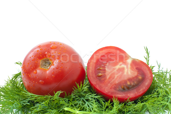 Ripe red tomato and half ower some dill Stock photo © digitalr