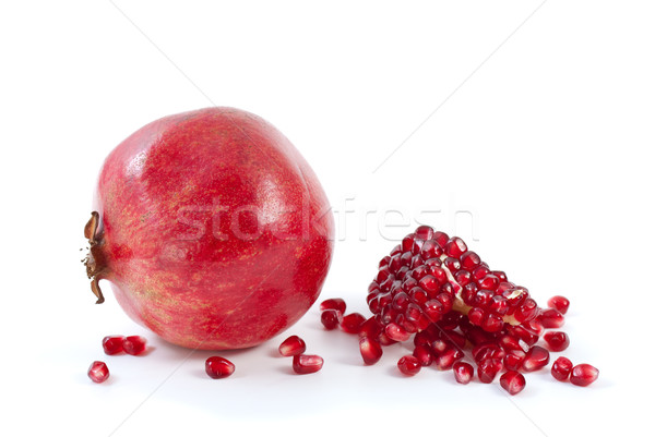Whole pomegranate\ piece and some beries Stock photo © digitalr