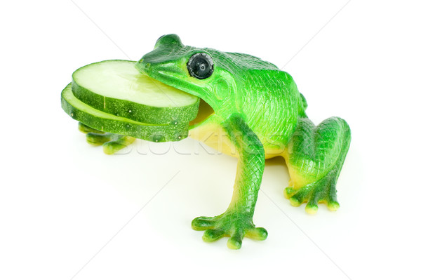 Toy frog with two cucumber slices in mouth Stock photo © digitalr