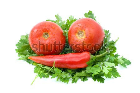 Two ripe tomatoes and red hot chili pepper over some parsley Stock photo © digitalr