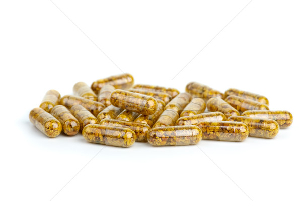 Pile of homeopathic pills with bee pollen Stock photo © digitalr