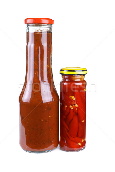 Bottles with tomato ketchup and marinated red hot chili peppers Stock photo © digitalr