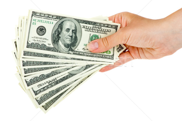 Hand holds bunch of $100 bills Stock photo © digitalr