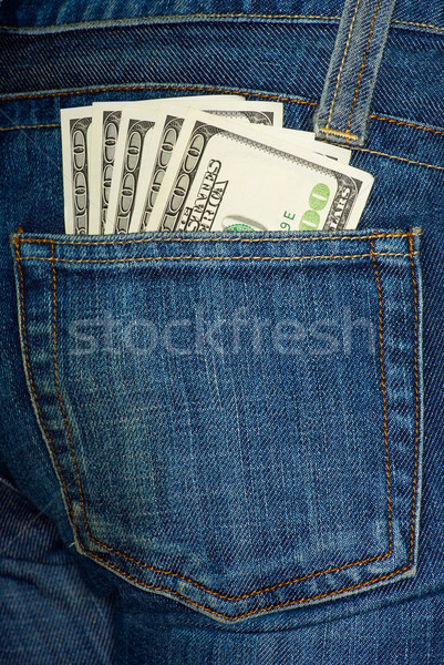 Jeans pocket with $100 bills Stock photo © digitalr