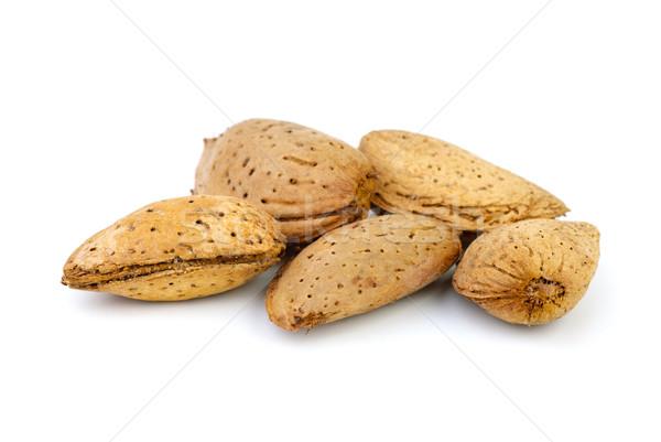 Five unshelled almonds Stock photo © digitalr