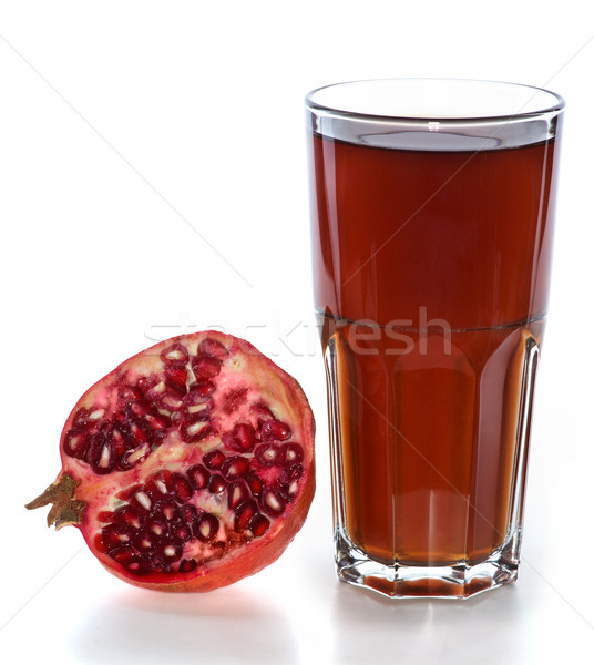Half of pomegranate fruit and glass with juice Stock photo © digitalr