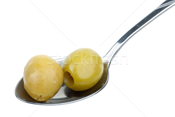Two marinated pitted green olives in the small metal spoon Stock photo © digitalr