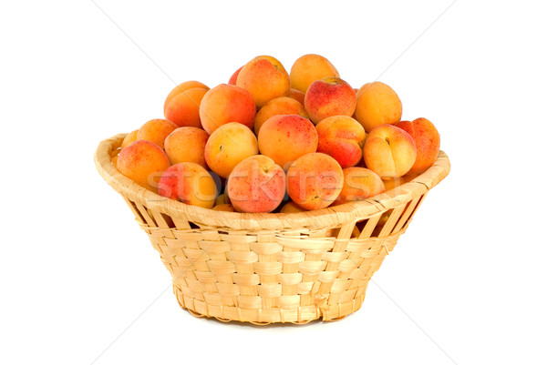 Wicker basket filled with apricots Stock photo © digitalr
