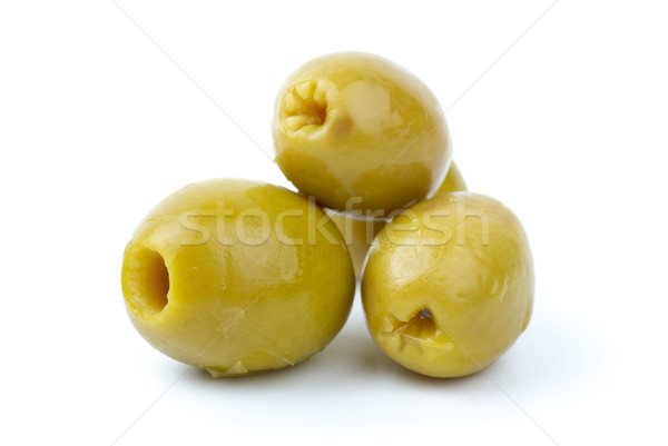 Three pitted marinated green olives close-up Stock photo © digitalr