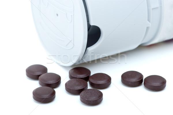 Some brown pills near pill-dispenser Stock photo © digitalr