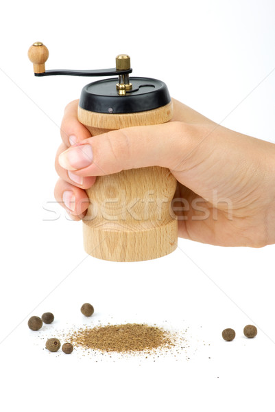 Wooden spice handmill in hand and allspice  Stock photo © digitalr