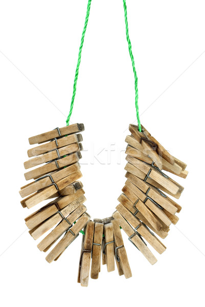 Few wooden clotespins hanging on the rope Stock photo © digitalr