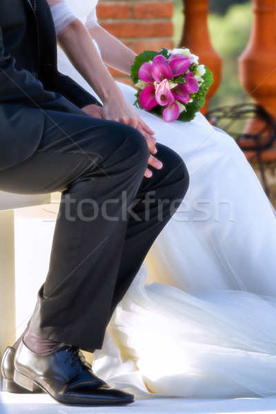 Bride and groom in bright clothes on the bench Stock photo © digoarpi
