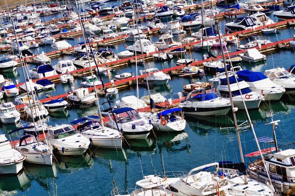 Kikötő motorcsónak tengerpart tenger nyár csónak Stock fotó © digoarpi